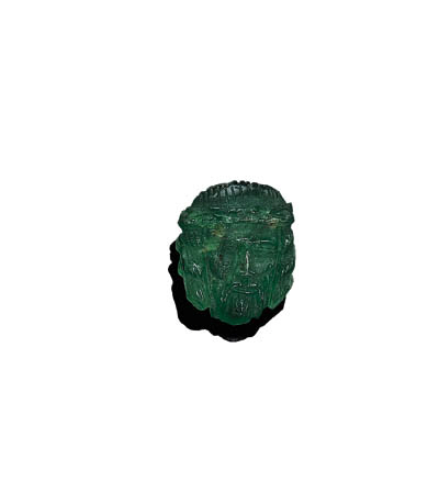 AN UNMOUNTED CARVED EMERALD