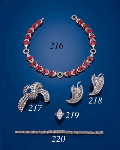 AN ART DECO CARVED RUBY AND DI