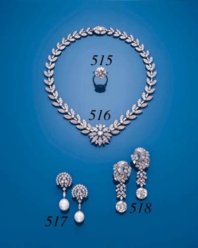 A PAIR OF DIAMOND EAR-PENDANTS
