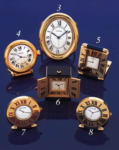 Cartier. A silver gilt desk cl