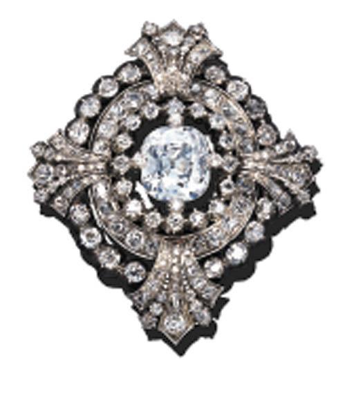 A DIAMOND OVAL MEDALLION BROOC