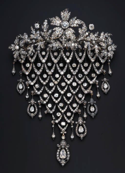 AN IMPRESSIVE DIAMOND STOMACHER BROOCH
