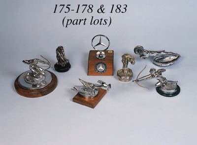 A group of hood ornaments incl