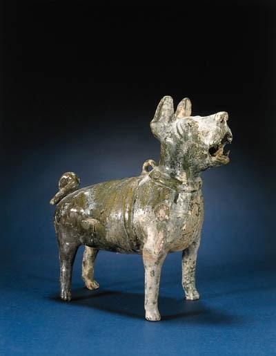 A GREEN-GLAZED POTTERY DOG