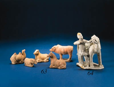 A GROUP OF FIVE RED POTTERY AN
