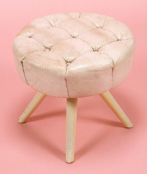 A LEATHER UPHOLSTERED SWIVELIN