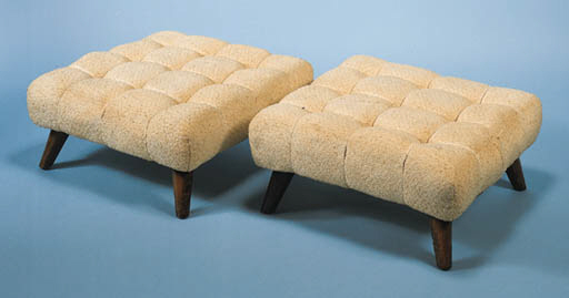A PAIR OF UPHOLSTERED OTTOMANS