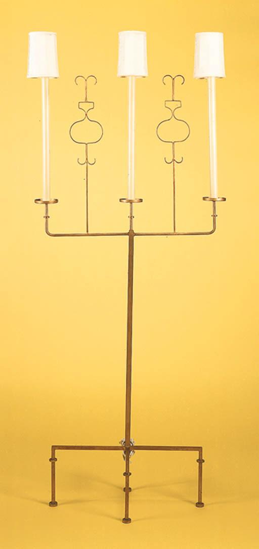 A GILT-METAL FLOOR LAMP