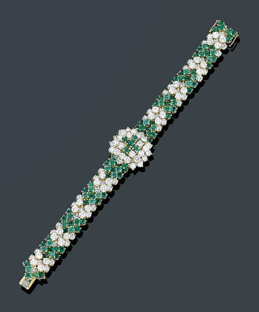A DIAMOND AND EMERALD WATCH BR