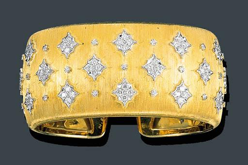 A GOLD AND DIAMOND CUFF BANGLE