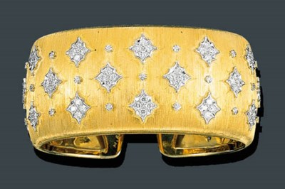 A GOLD AND DIAMOND CUFF BANGLE