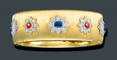 A GOLD, SAPPHIRE AND RUBY CUFF