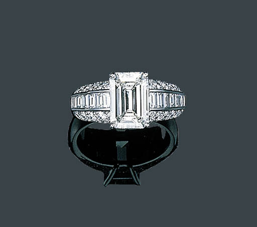 A PLATINUM AND DIAMOND RING, B