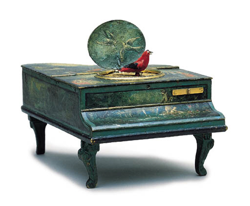 A WHIMSICAL METAL PIANO SINGIN