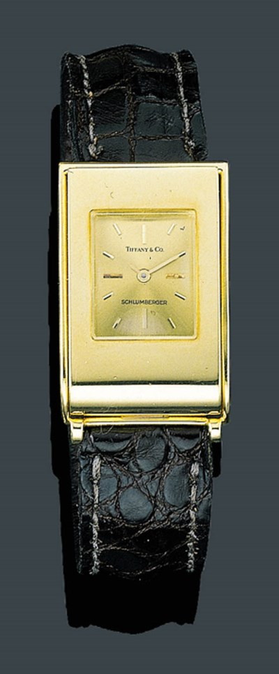 AN 18K GOLD WRISTWATCH, SCHLUM