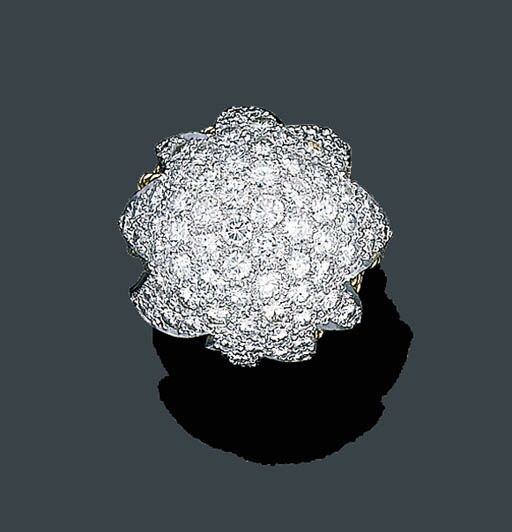 A PLATINUM, GOLD AND DIAMOND BOMB RING