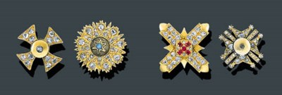 A PAIR OF GOLD AND GEM SET CUF