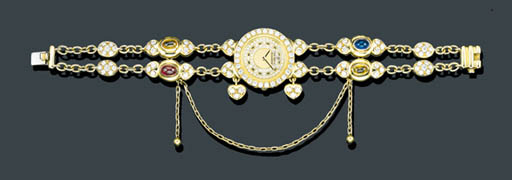 A LADY'S 18K GOLD AND GEM SET