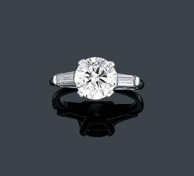 A CIRCULAR-CUT DIAMOND RING