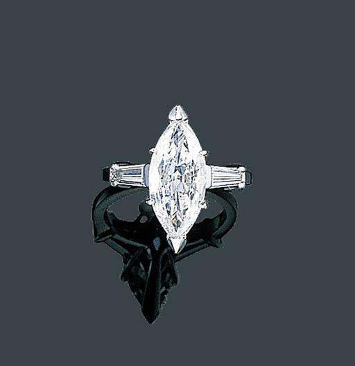 A PLATINUM AND DIAMOND RING