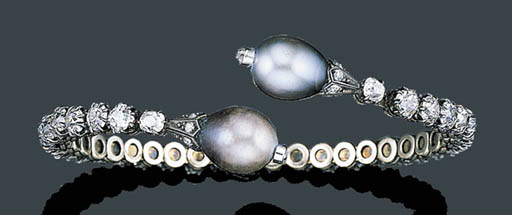 AN ANTIQUE NATURAL PEARL AND D