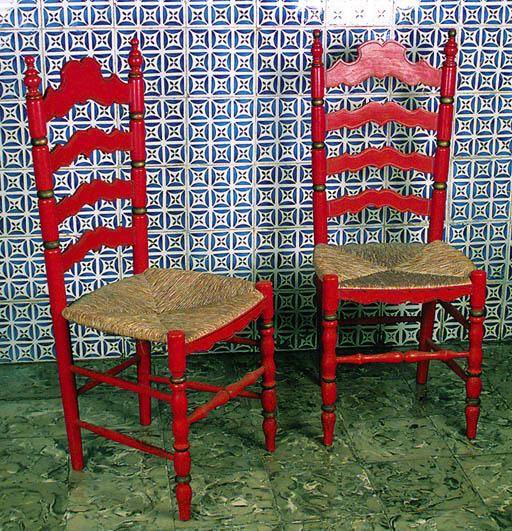 Juego de veinticuatro sillas d