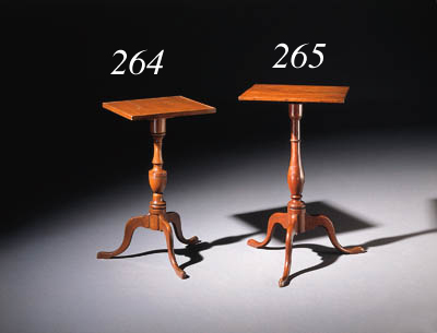 A CHIPPENDALE MAHOGANY CANDLES