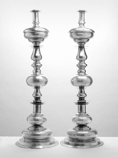 A PAIR OF ALTAR CANDLESTICKS