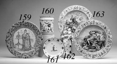 A FRENCH FAIENCE FIGURE GROUP