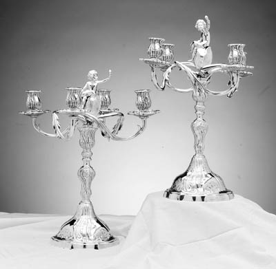 A PAIR OF CONTINENTAL SILVER FOUR-LIGHT CANDELABRA