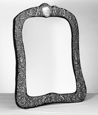 A LARGE SILVER MOUNTED DRESSING TABLE MIRROR