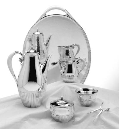 A DANISH FOUR-PIECE SILVER COFFEE SERVICE ON TWO-HANDLED TRAY**