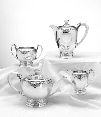 A GEORGE VI FOUR-PIECE SILVER