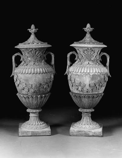 A PAIR OF LARGE TERRACOTTA COV