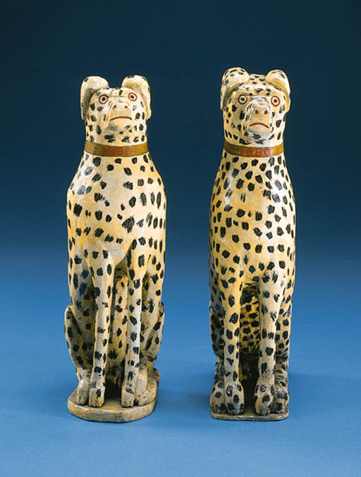 A PAIR OF CARVED AND PAINTED S