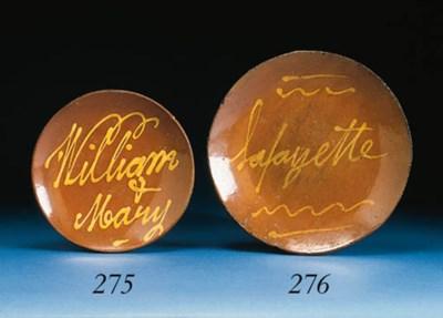 A SLIP-DECORATED GLAZED REDWAR
