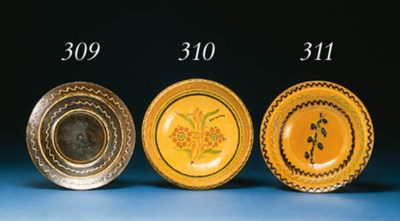 A SLIP-DECORATED REDWARE PLATE