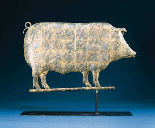 A MOLDED AND GILDED COPPER PIG