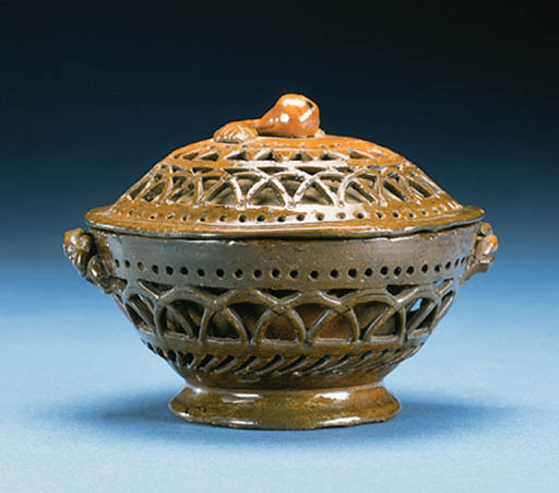 A COVERED REDWARE BOWL