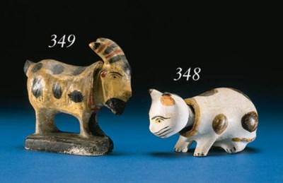 A CHALKWARE NODDING CAT