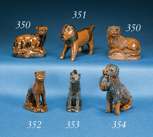 A PAIR OF GLAZED REDWARE LIONS