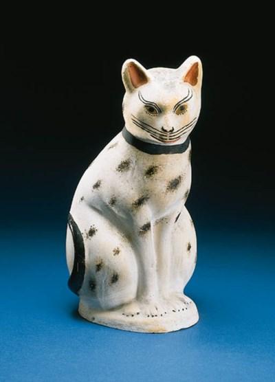 A CHALKWARE FIGURE OF A CAT