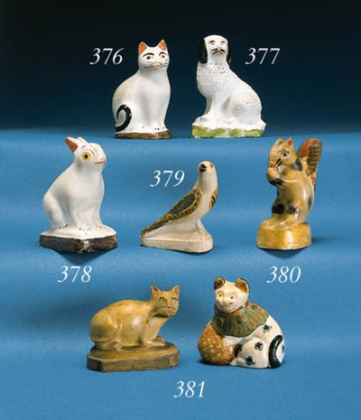 A CHALKWARE FIGURE OF A CAT