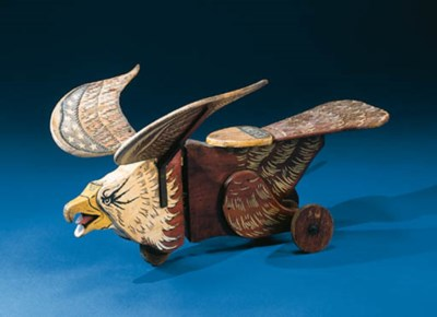 A PAINTED EAGLE TRICYCLE