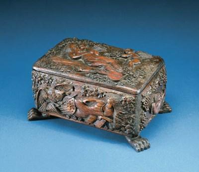 A CARVED MAHOGANY BOX