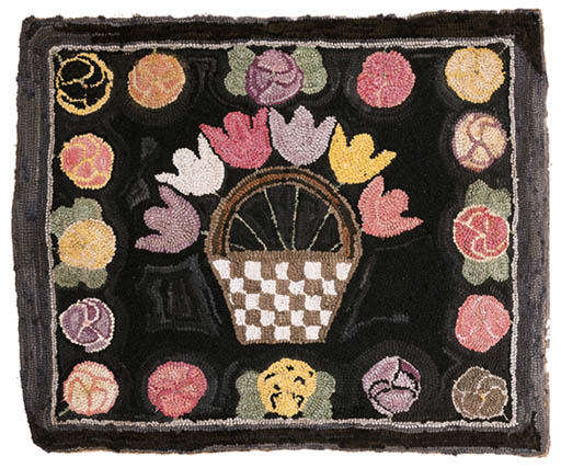 A WOOL AND COTTON HOOKED RUG