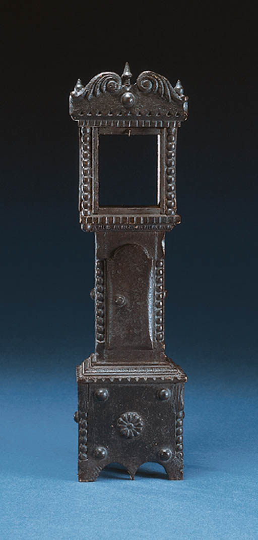 A CARVED WOODEN WATCH HOLDER