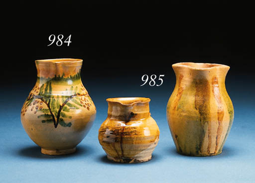 TWO SLIP-WASHED REDWARE PITCHE