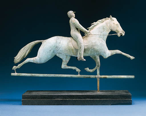 A MOLDED COPPER AND ZINC HORSE