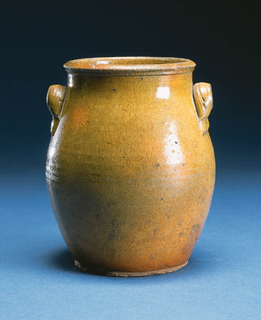 A GREEN-GLAZED TWO-HANDLED CRO